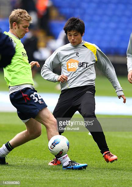 Ryo Miyaichi of Bolton Wanderers in warm up with team mate Tim Ream prior to the start of the Barclays Premier League match between Bolton Wanderers...