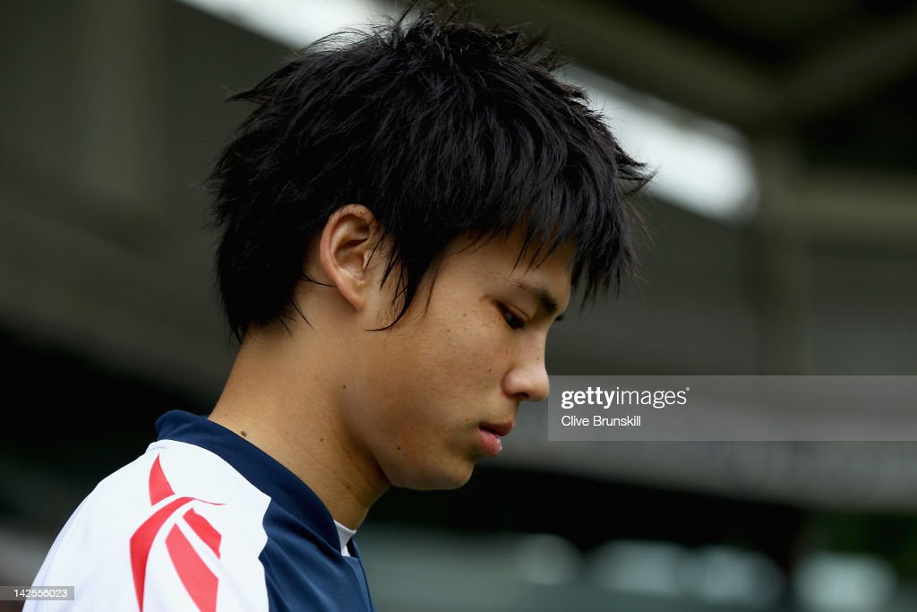 <a gi-track='captionPersonalityLinkClicked' href=/galleries/search?phrase=Ryo+Miyaichi&family=editorial&specificpeople=6444719 ng-click='$event.stopPropagation()'>Ryo Miyaichi</a> of Bolton Wanderers walks onto the pitch before the start of the Barclays Premier League match between Bolton Wanderers and Fulham at Reebok Stadium on April 7, 2012 in Bolton, England.