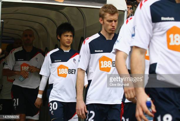 Ryo Miyaichi of Bolton Wanderers walks onto the pitch before the start of the Barclays Premier League match between Bolton Wanderers and Fulham at...