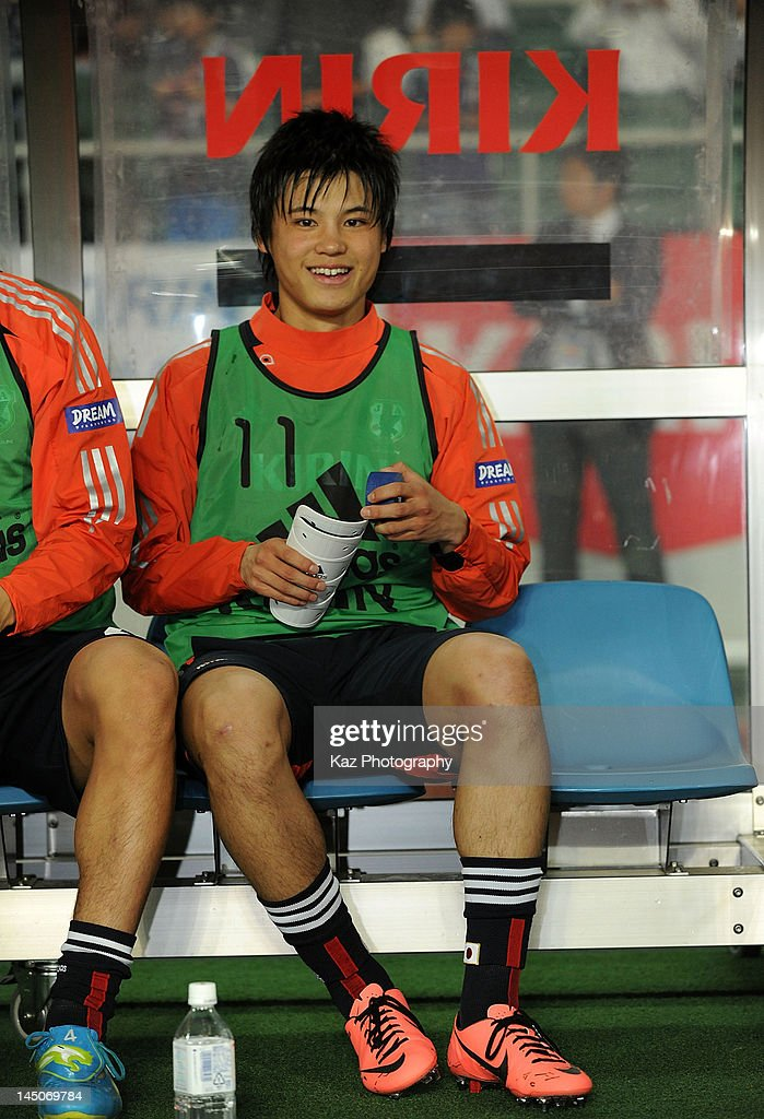 <a gi-track='captionPersonalityLinkClicked' href=/galleries/search?phrase=Ryo+Miyaichi&family=editorial&specificpeople=6444719 ng-click='$event.stopPropagation()'>Ryo Miyaichi</a> of Japan smiles on the bench after being replaced during the international friendly match between Japan and Azerbaijan at Ecopa Stadium on May 23, 2012 in Kakegawa, Japan.