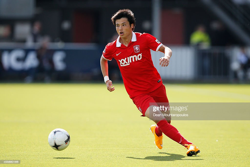 <a gi-track='captionPersonalityLinkClicked' href=/galleries/search?phrase=Ryo+Miyaichi&family=editorial&specificpeople=6444719 ng-click='$event.stopPropagation()'>Ryo Miyaichi</a> of Twente in action during the Dutch Eredivisie match between Heracles Almelo and FC Twente at Polman Stadion on September 21, 2014 in Almelo, Netherlands.
