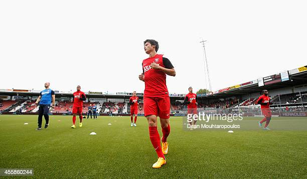 Ryo Miyaichi of Twente warms up prior to the Dutch Eredivisie match between Heracles Almelo and FC Twente at Polman Stadion on September 21 2014 in...