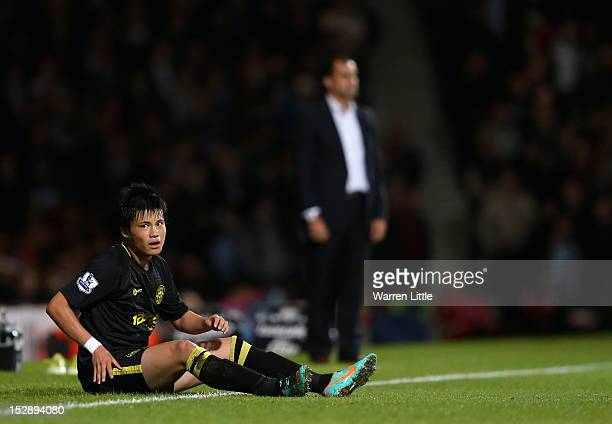 Ryo Miyaichi of Wigan Athletic looks on during the Capital One Cup Third Round match between West Ham and Wigan Athletic on September 25 2012 in...