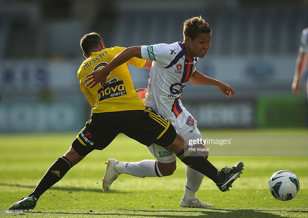 Ryo Nagai of Perth is tackled by Emmanuel Muscat of the Phoenix during the round 19 A-League match between the Wellington Phoenix and the Perth Glory at Eden Park on February 2, 2013 in Auckland, New Zealand.