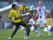 Ryo Nagai of Perth is tackled by Leo Bertos of the Phoenix during the round 19 ALeague match between the Wellington Phoenix and the Perth Glory at...