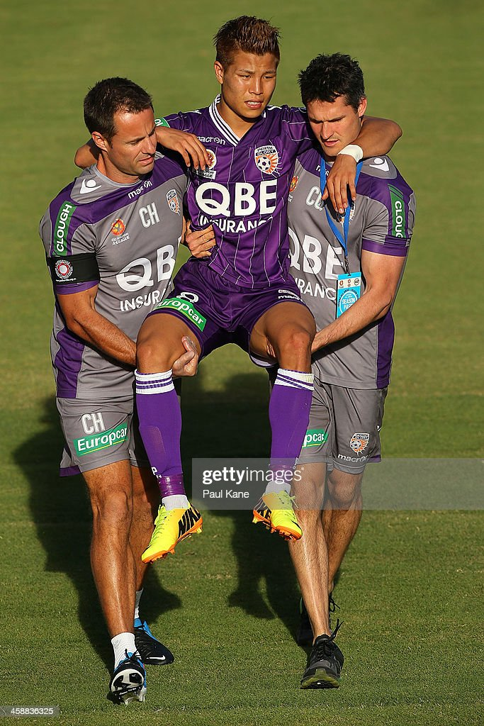 Ryo Nagai of the Glory is carried from the field with an injury during the round 11 A-League match between Perth Glory and Adelaide United at nib Stadium on December 22, 2013 in Perth, Australia.