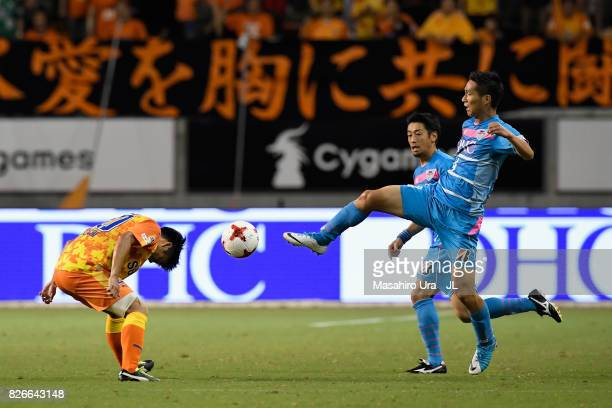 Ryo Takeuchi of Shimizu SPulse and Riki Harakawa of Sagan Tosu compete for the ball during the JLeague J1 match between Sagan Tosu and Shimizu SPulse...