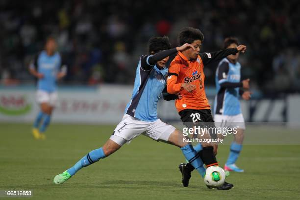 Ryo Takeuchi of Shimizu SPulse and Yuki Kobayashi of Jubilo Iwata compete for the ball during the JLeague match between Shimizu SPulse and Jubilo...