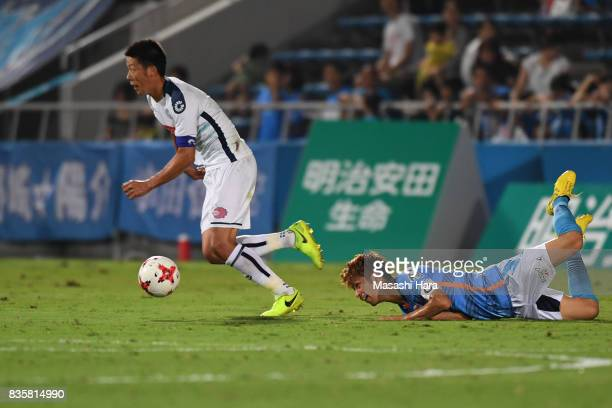 Ryohei Hayashi of Mito Hollyhock and Kensuke Sato compete for the ball during the JLeague J2 match between Yokohama FC and Mito Hollyhock at Nippatsu...