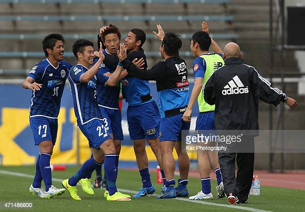 Ryohei Hayashi of Montedio Yamagata celebrates scoring his team's third goal with his team mates during the JLeague match between Shimizu SPulse and...