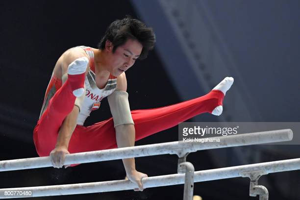 Ryohei Kato competes in the Parallel Barsduring Japan National Gymnastics Apparatus Championships at the Takasaki Arena on June 25 2017 in Takasaki...