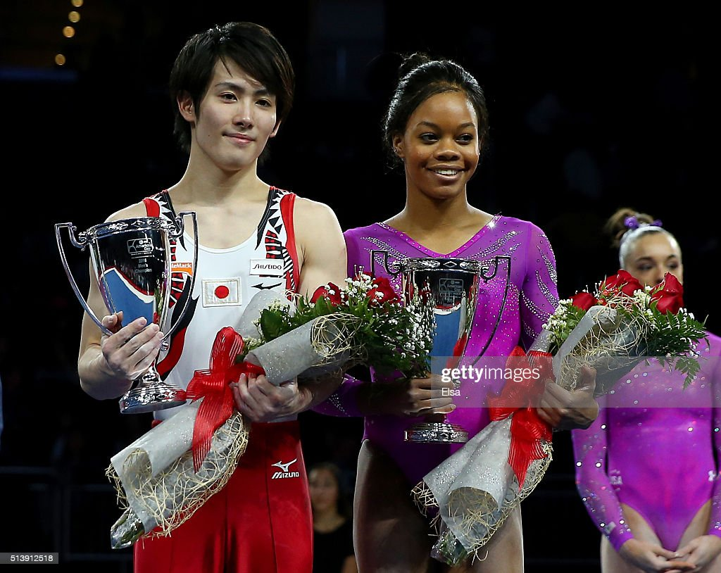 Ryohei Kato of Japan and Gabrielle Douglas of the United States celebrate their win of the the 2016 AT&T American Cup on March 5, 2016 at Prudential Center in Newark, New Jersey.