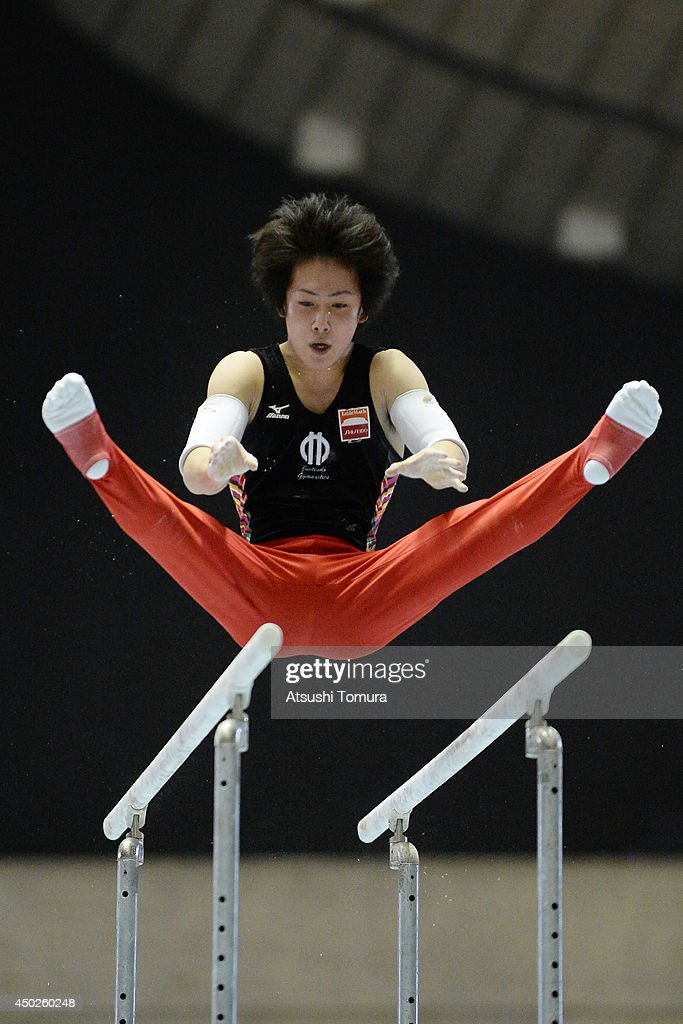 Ryohei Kato of Japan competes on the Parallel Bars during day two of the Artistic Gymnastics NHK Trophy at Yoyogi National Gymnasium on June 8, 2014 in Tokyo, Japan.