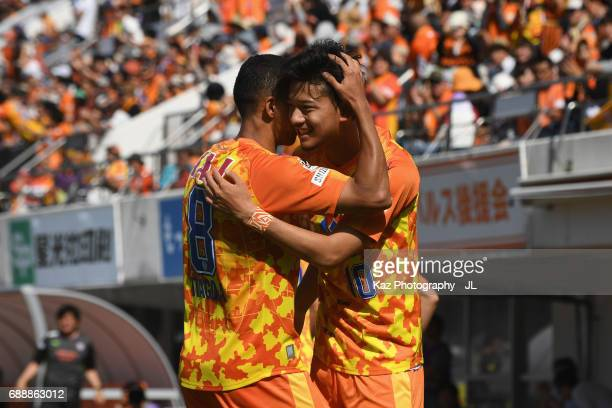 Ryohei Shirasaki of Shimizu SPulse celebrates scoring his side's first goal with his team mate Tiago Alves during the JLeague J1 match between...