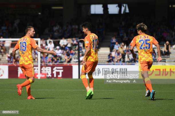 Ryohei Shirasaki of Shimizu SPulse celebrates scoring his side's first goal with his team mates Mitchell Duke and Ko Matsubara during the JLeague J1...