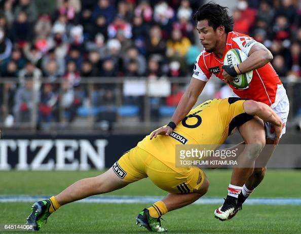 TOPSHOT Ryohei Yamanaka of the Sunwolves is tackled by Dane Coles of the Hurricanes during the Super Rugby match between the Sunwolves of Japan and...