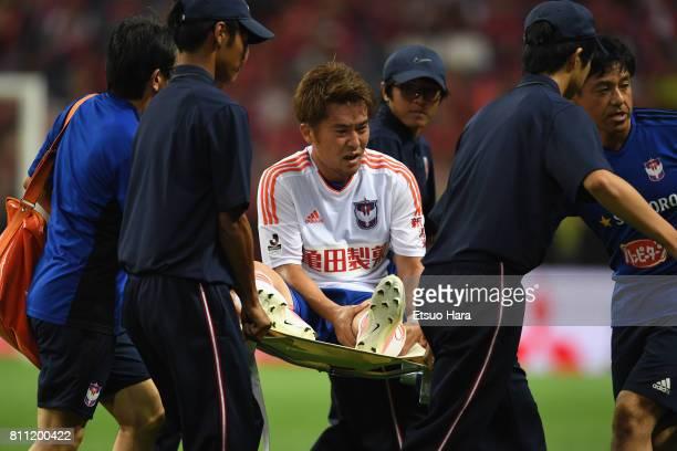 Ryohei Yamazaki of Albirex Niigata is taken off by a stretcher during the JLeague J1 match between Urawa Red Diamonds and Albirex Niigata at Saitama...