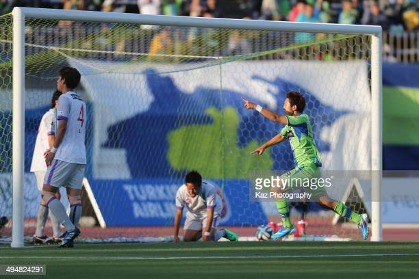 Ryohei Yoshihama of Shonan Bellmare celebrates scoring his team's first goal during the JLeague second division match between Shonan Bellmare and...