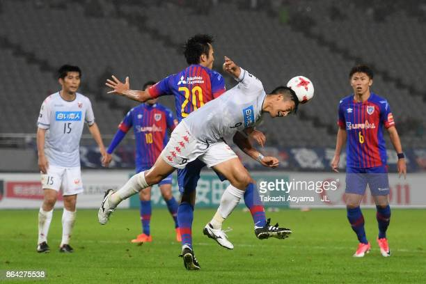 Ryoichi Maeda of FC Tokyo and Ken Tokura of Consadole Sapporo compete for the ball during the JLeague J1 match between FC Tokyo and Consadole Sapporo...