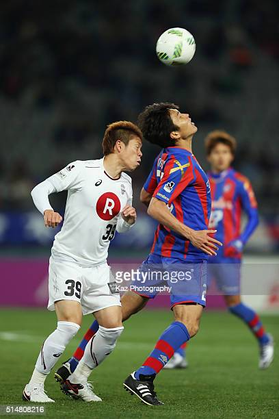 Ryoichi Maeda of FC Tokyo and Masahiko Inoha of Vissel Kobe compete for the ball during the JLeague match between FC Tokyo and Vissel Kobe at the...