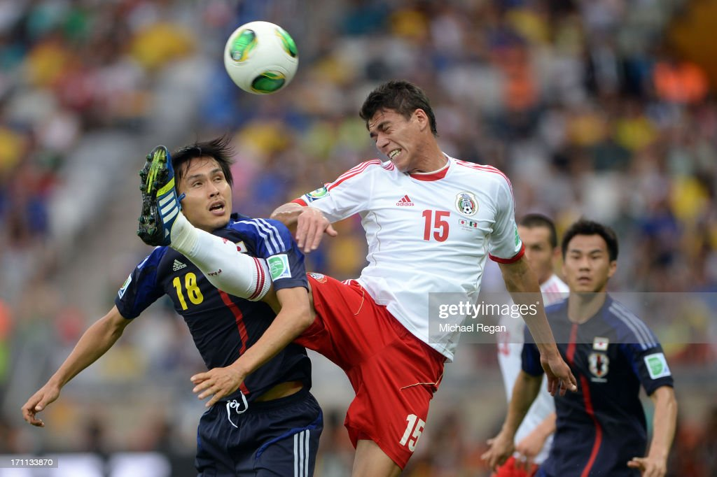 Ryoichi Maeda of Japan fights for the ball against Hector Moreno of Mexico during the FIFA Confederations Cup Brazil 2013 Group A match between Japan and Mexico at Estadio Mineirao on June 22, 2013 in Belo Horizonte, Brazil.