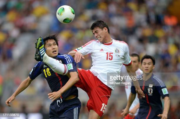 Ryoichi Maeda of Japan fights for the ball against Hector Moreno of Mexico during the FIFA Confederations Cup Brazil 2013 Group A match between Japan...