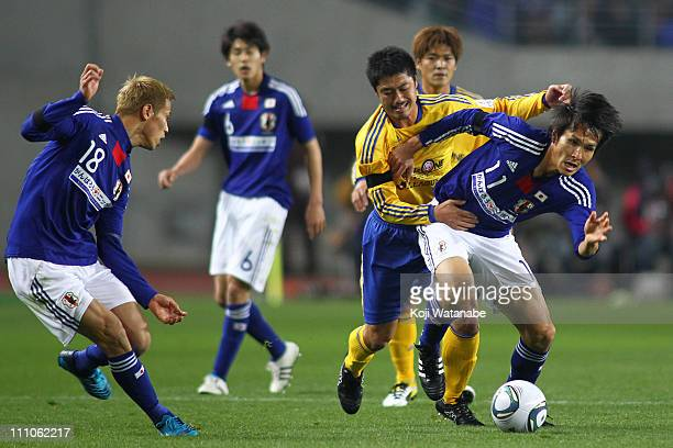 Ryoichi Maeda of Japan national team and Mitsuo Ogasawara of JLeague XI 'Team As One' compete for the ball during the charity match for those suffer...