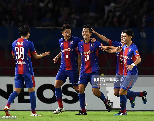 Ryoichi Meda of FC Tokyo celebrates scoring his team's third goal to make a hat trick with his team mates during the JLeague match between FC Tokyo...