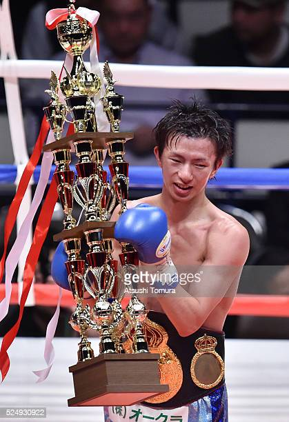 Ryoichi Taguchi of Japan poses with the trophy after defeating Juan Jose Landaeta of Venezuela to defend the WBA Light flyweight title on April 27...