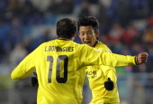 Ryoishi Kurisawa of Kashiwa Reysol celebrates after scoring a goal with Leandro Domingues during the AFC Champions League Group H match between Suwon...