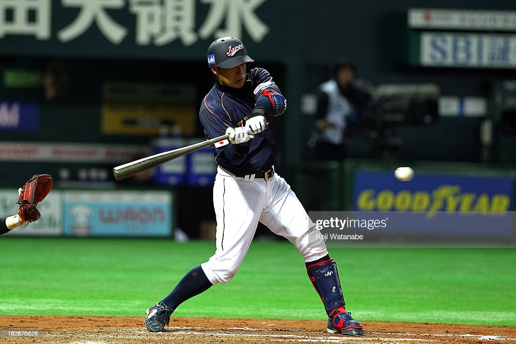 <a gi-track='captionPersonalityLinkClicked' href=/galleries/search?phrase=Ryoji+Aikawa&family=editorial&specificpeople=845211 ng-click='$event.stopPropagation()'>Ryoji Aikawa</a> #2 of Japan hits a single in the top half of the eighth inning during the friendly game between Yomiuri Giants and Japan at Fukuoka Yafuoku! Dome on February 28, 2013 in Fukuoka, Japan.