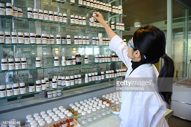 Ryoko Akatsu a student from Japan selects fragrances and oils in a laboratory at the Givaudan Perfumery School on July 4 2012 in Argenteuil northern...
