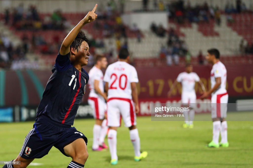 Ryoma Watanabe of Japan celebrates his team's second goal during the FIFA U-17 World Cup UAE 2013 Group D match between Japan and Tunisia at Sharjah Stadium on October 24, 2013 in Sharjah, United Arab Emirates.
