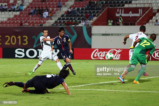 Ryoma Watanabe of Japan scores his team's second goal during the FIFA U17 World Cup UAE 2013 Group D match between Japan and Venezuela at Sharjah...