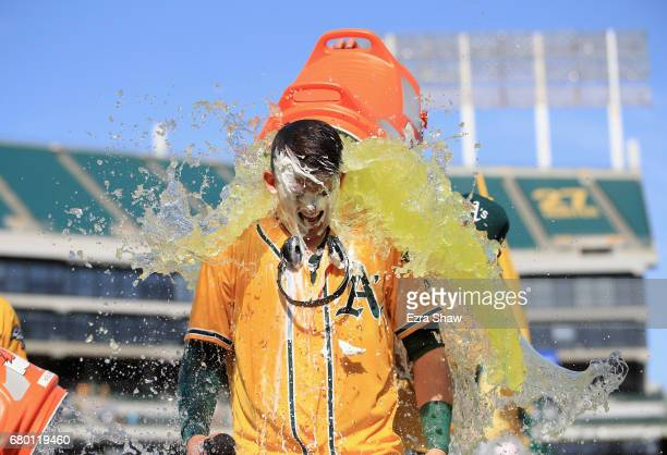 Ryon Healy of the Oakland Athletics is covered in Gatorade after he hit a walkoff home run in the ninth inning against the Detroit Tigers at Oakland...