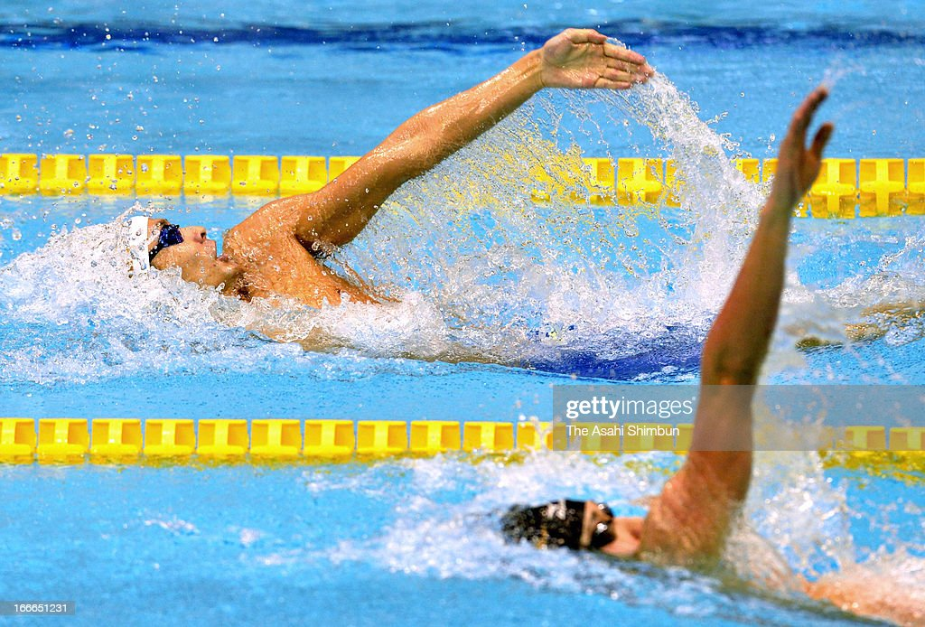 Ryosuke Irie and runnerup Kosuke Hagino compete in the Men's 200m Backstroke during day four of the Japan Swim 2013 at Daiei Probis Phoenix Pool on...