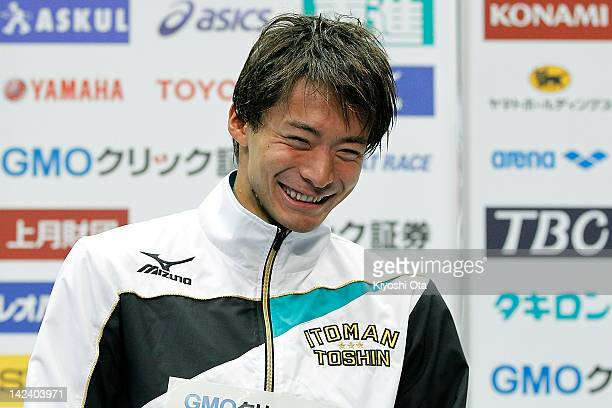 Ryosuke Irie celebrates on the podium after winning the Men's 100m Backstroke final at an award ceremony during day three of the Japan Swim 2012 at...