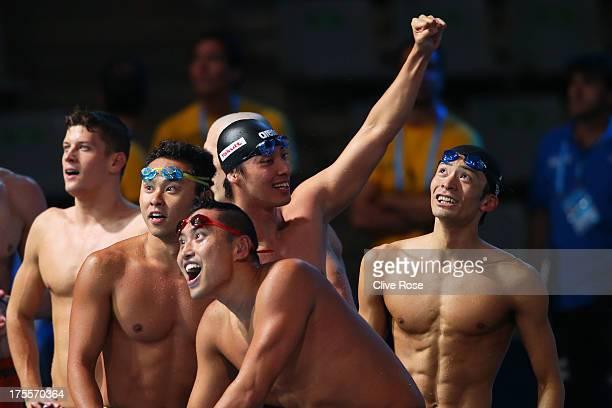 Ryosuke Irie Kosuke Kitajima Takuro Fujii and Shinri Shioura of Japan celebrate after the USA are disqualified and they are instated as bronze medal...