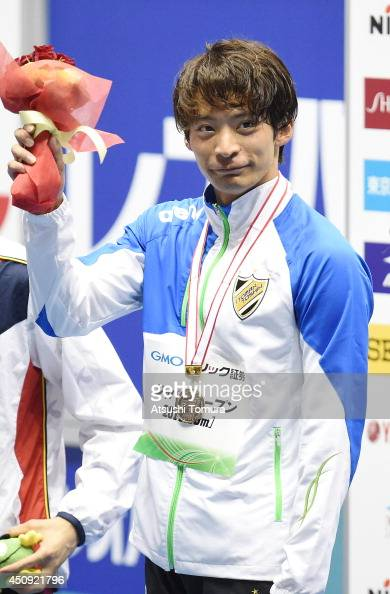 Ryosuke Irie of Japan celebrates on the podium after winning the men 200m Backstroke Final during day two of the Japan Open 2014 at Tokyo Tatsumi...