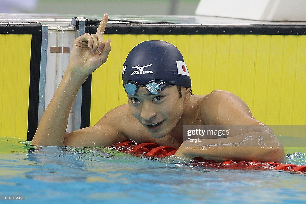 Ryosuke Irie of Japan celebrates winning the gold medal in Men's 50m Backstroke Final during Swimming Day Three of the 26th Summer Universiade at...