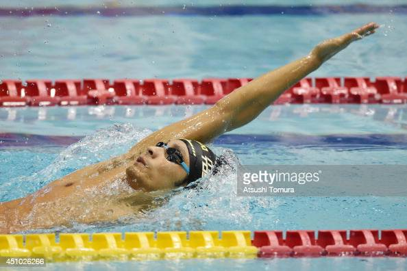 Ryosuke Irie of Japan competes in the men 200m Backstroke Final during day four of the Japan Open 2014 at Tokyo Tatsumi International Swimming Pool...