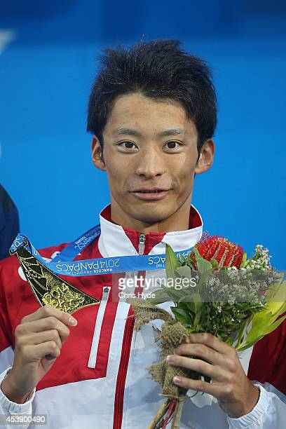 Ryosuke Irie of Japan holds the gold medal after winning the Men's 100m Backstroke final during day one of the 2014 Pan Pacific Championships at Gold...