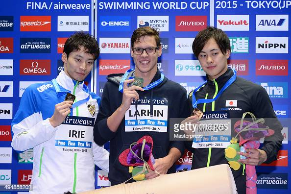 Ryosuke Irie of Japan Mitchell Larkin of Australia and Masaki Kaneko of Japan pose on the podium after the Men's 200m Backstroke final during the...