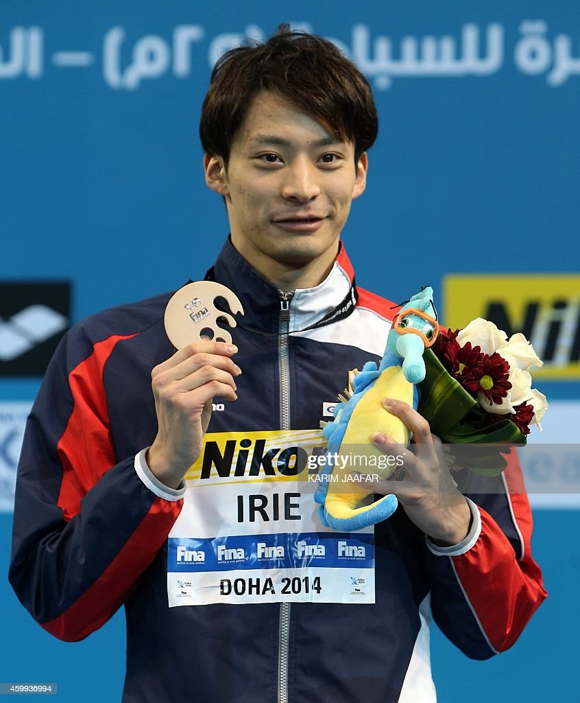Ryosuke Irie of Japan poses with the bronze medal following the Men's backstroke 100m during the 12th FINA World Swimming Championships in Doha on...