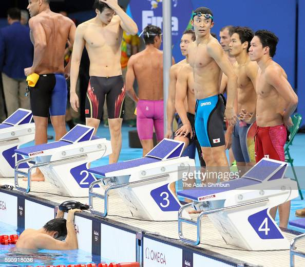 Ryosuke Irie Yasuhiro Koseki Takukro Fujii and Katsumi Nakamura of Japan react after competing in the Men's 4x100m Medley Relay Final on Day 8 of the...