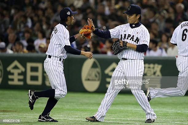Ryosuke Kikuchi of Samurai Japan and Takahiro Norimoto of Samurai Japan celebrate in the seventh inning during the game three of Samurai Japan and...