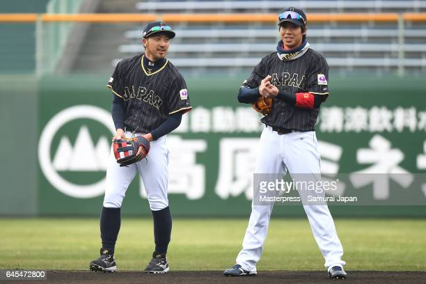 Ryosuke Kikuchi and Tetsuto Yamada of Japan looks on during SAMURAI JAPAN's training camp at the Sun Marine Stadium Miyazaki on February 26 2017 in...