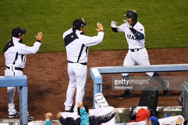 Ryosuke Kikuchi of Japan celebrates his gametying home run with Manager Hiroki Kokubo during the Game 2 of the Championship Round of the 2017 World...