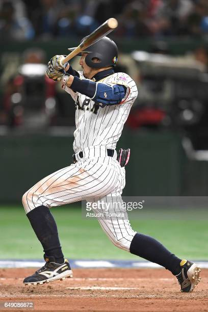 Ryosuke Kikuchi of Japan hits a RBI single in the fifth inning of the World Baseball Classic Pool B Game One between Cuba and Japan at Tokyo Dome on...