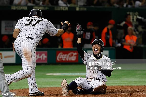 Ryosuke Kikuchi of Japan slides safely into the home base after Hayato Sakamoto of Japan hits threerun double in the fifth inning during the...
